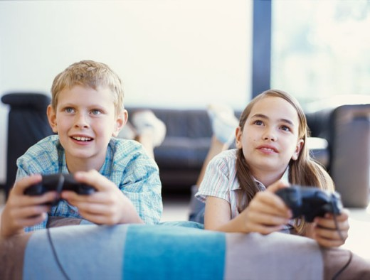 Stock Photo: 1491R-256031 boy and a girl playing video game
