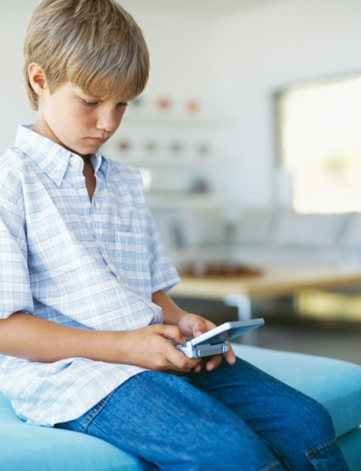 Stock Photo: 1491R-256066 boy playing a video game