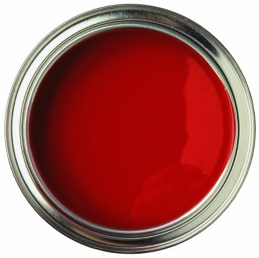 high angle view of an open can of red paint : Stock Photo