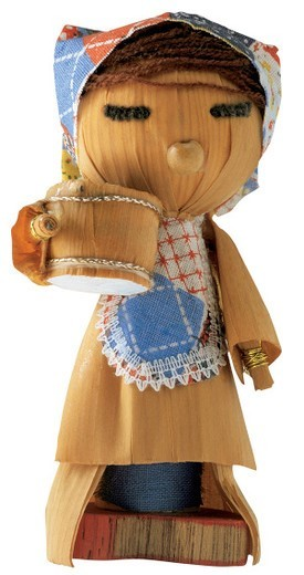 wooden carving of female doll : Stock Photo