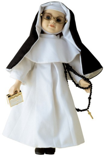 a nun doll holding a rosary : Stock Photo