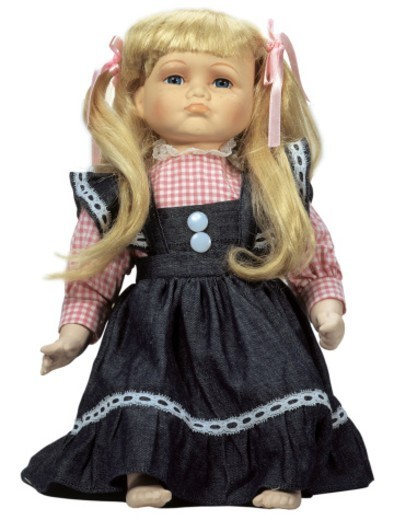 female doll wearing a dress : Stock Photo