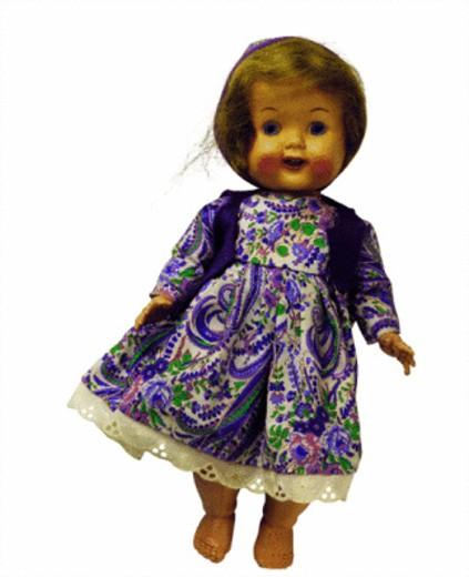 female doll in purple dress : Stock Photo