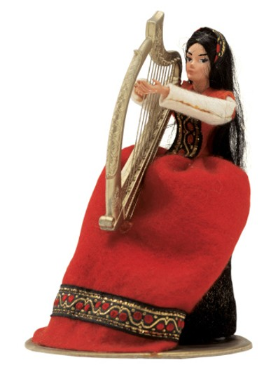 female doll playing harp : Stock Photo