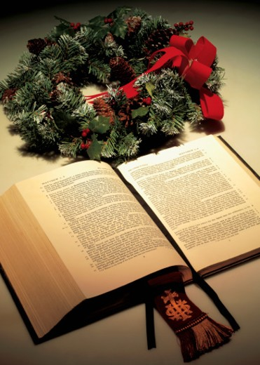 high angle view of a an open bible lying beside a wreath : Stock Photo