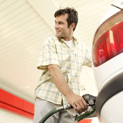 Stock Photo: 1491R-975421 man pumping gas