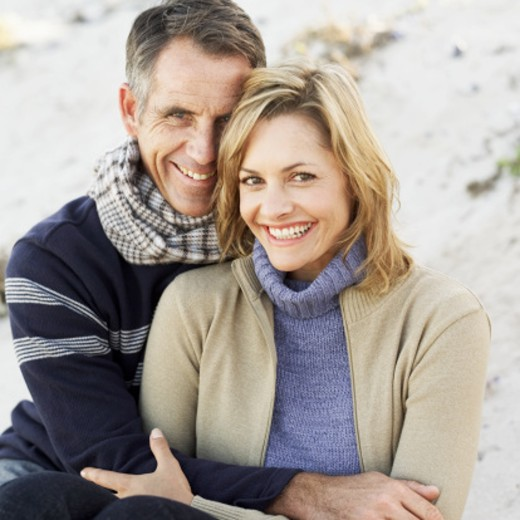 Portrait of a couple holding each other smiling : Stock Photo