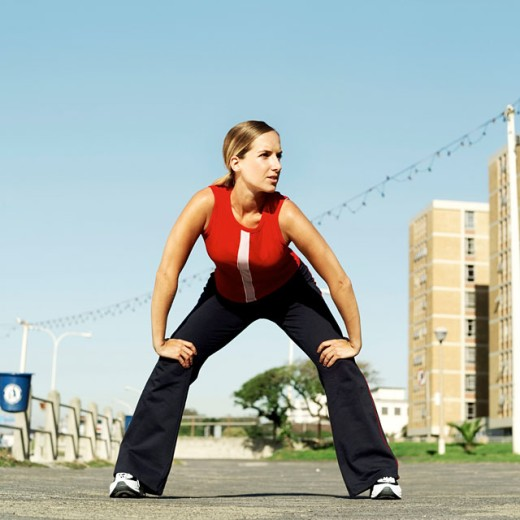woman exercising outdoors : Stock Photo