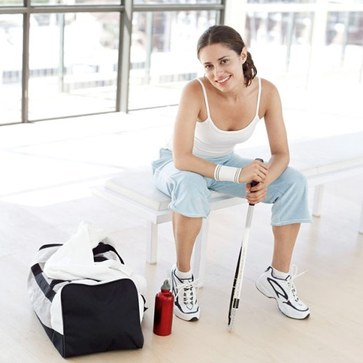 Stock Photo: 1491R-978143 portrait of a woman sitting with a racket