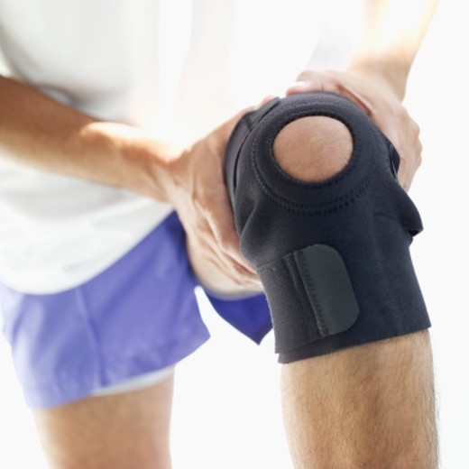 close-up of a man's knee support : Stock Photo