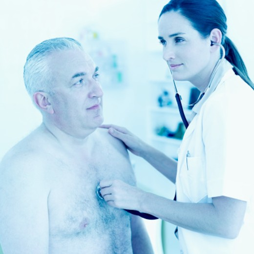 nurse checking heart beat of elderly man with a stethoscope : Stock Photo