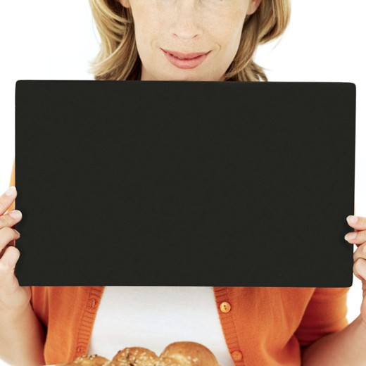 Stock Photo: 1491R-981226 woman holding up a blank black board