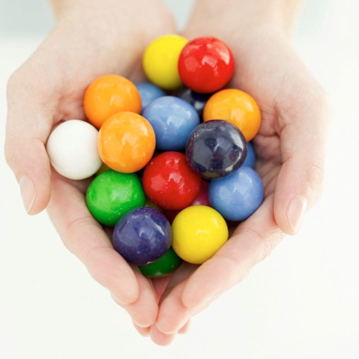 Stock Photo: 1491R-982087 close-up of hands holding assorted colors of gumballs