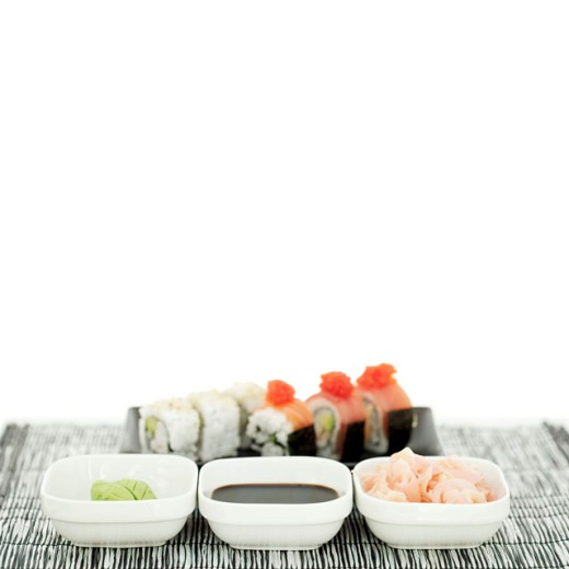 Stock Photo: 1491R-982375 an array of condiments served with sushi rolls