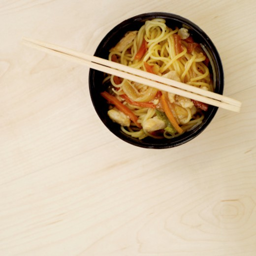 elevated view of a bowl of noodles and chopsticks : Stock Photo