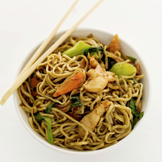 high angle view of chinese noodles in a bowl and a pair of chopsticks : Stock Photo