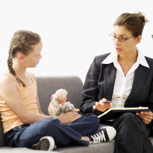 Stock Photo: 1491R-987738 girl (8-9) taking to a child psychologist