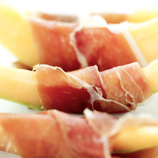 Stock Photo: 1491R-988086 close-up of melon and parma ham
