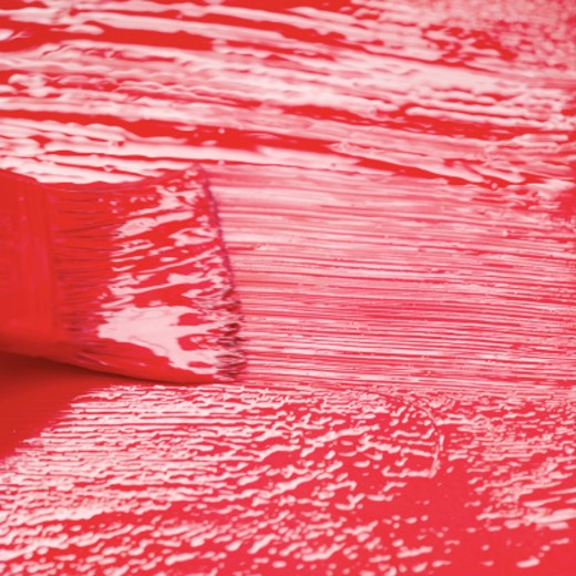 Stock Photo: 1491R-989357 Close-up of a paint brush adding a coat of red paint on a wooden surface