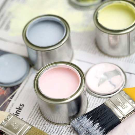 close-up of three open paint cans and a paint brush : Stock Photo