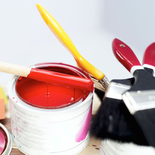 close-up of a paint bucket and paint brushes : Stock Photo