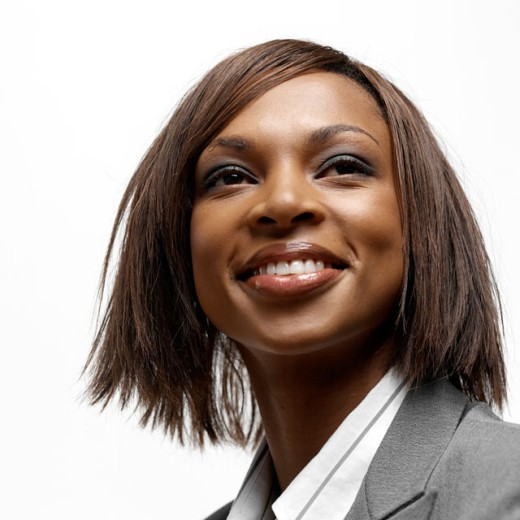 Stock Photo: 1491R-995040 Close-up of a young businesswoman looking ahead smiling