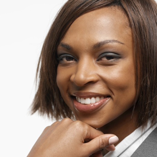 Close-up of a young businesswoman looking at camera smiling : Stock Photo