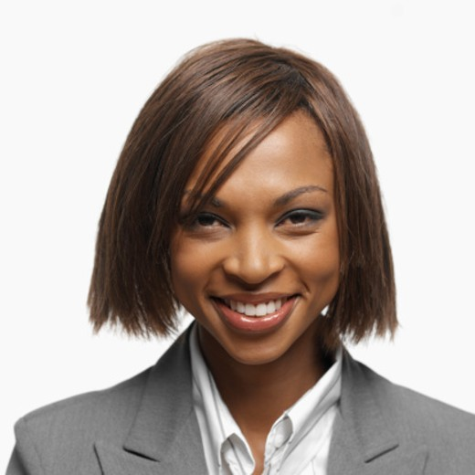 Portrait of a young businesswoman smiling : Stock Photo