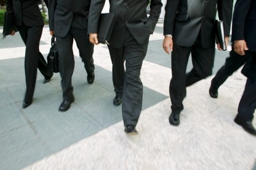 Business executives walking together : Stock Photo