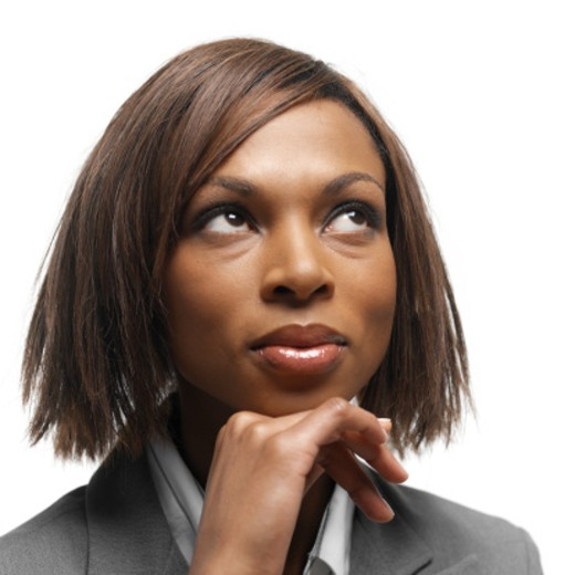 Close-up of a young businesswoman looking up : Stock Photo