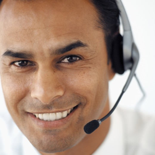 Portrait of a young businessman wearing a headset : Stock Photo