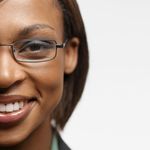 Stock Photo: 1491R-995493 Portrait of a young businesswoman looking at camera smiling