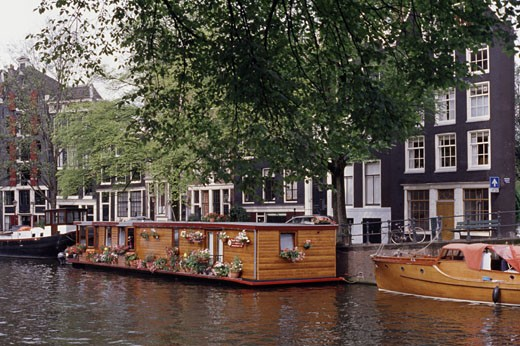 Houseboats in a canal, Amsterdam, Netherlands : Stock Photo