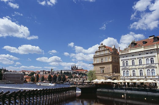 Buildings on the waterfront, Vltava River, Prague, Czech Republic : Stock Photo