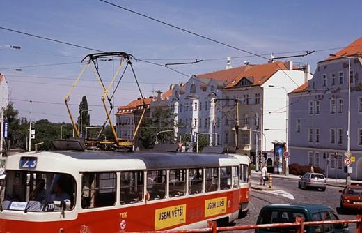 Stock Photo: 1495-575 Tram moving on a road, Red Electric Tram, Prague, Czech Republic