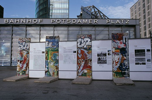Monument in front of a building, Berlin Wall Monument, Potsdamer Platz, Berlin, Germany : Stock Photo