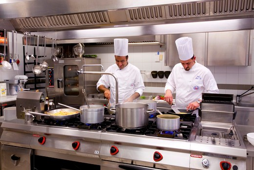 Chefs preparing food in in the kitchen of a hotel, Hotel Regina, Forte Dei Marmi, Province of Lucca, Tuscany, Italy : Stock Photo