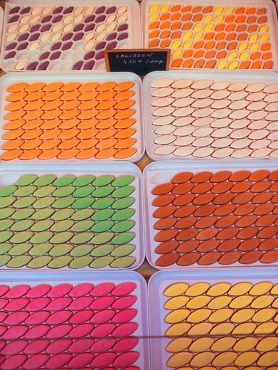 France, Nice, Trays of colorful calisson - traditional French almond candy on sale at farmers market in old town : Stock Photo