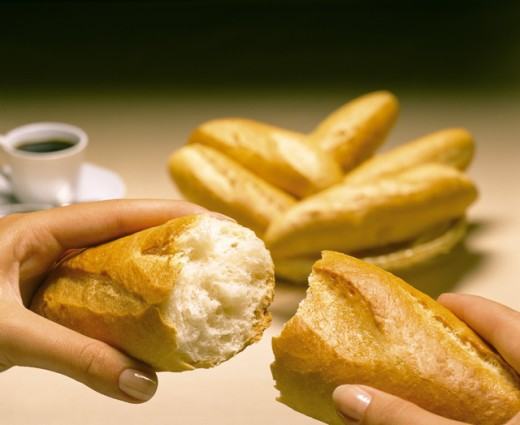 Stock Photo: 1497-212 Close-up of a woman's hands holding pieces of baguettes