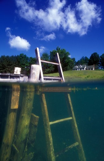 Close-up of a ladder and wooden posts in water, Vermont, USA : Stock Photo