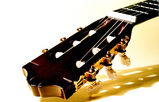 Close-up of the head of an acoustic guitar : Stock Photo