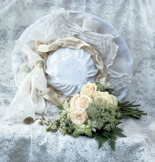 Stock Photo: 1516R-119 Hat with a lace and a floral arrangement