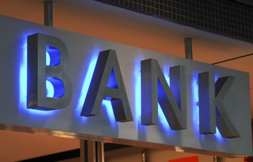 Low angle view of an illuminated bank sign : Stock Photo