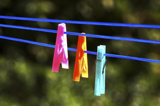 Stock Photo: 1517-511 Close-up of three clothes pegs on clotheslines
