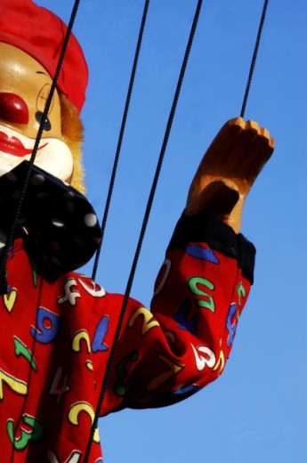 Stock Photo: 1517-631 Low angle view of a puppet hanging on strings