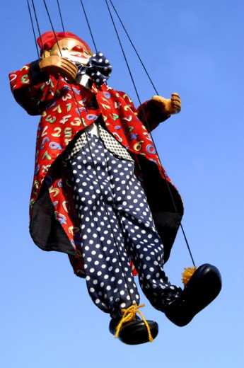 Stock Photo: 1517-635 Low angle view of a puppet hanging on strings