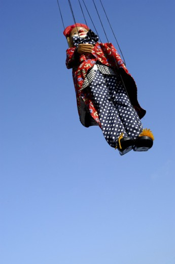 Stock Photo: 1517-636 Low angle view of a puppet hanging on strings
