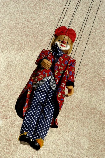 Puppet hanging on strings : Stock Photo