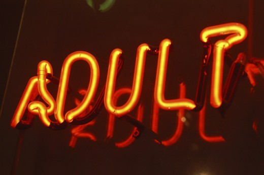 Stock Photo: 1517-849 Close-up of a neon adult sign lit up at night