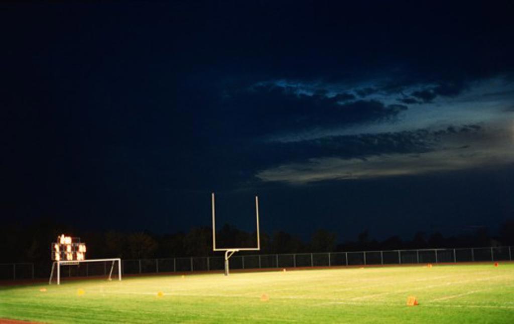 Stock Photo: 1522-110 Goal post in an empty football field at night, Missouri, USA